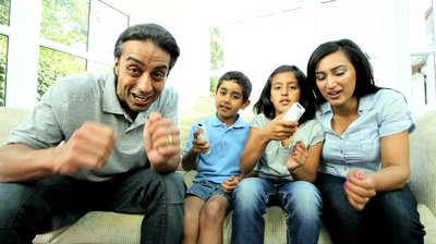 gaming benefit - stock-footage-asian-children-enjoying-home-games-console