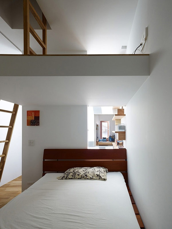 Bedroom-with-other-place-room-there-and-the-second-floor-with-other-room-wooden-staircase-laminate-flooring-picture-frame-and-wooden-chase-there