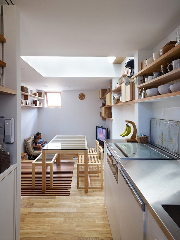 Kitchen-area-with-kitchen-cabinet-chase-place-for-some-tool-for-cook-and-eat-laminate-flooring-and-the-by-side-a-place-dinning-with-sofass-long-chair