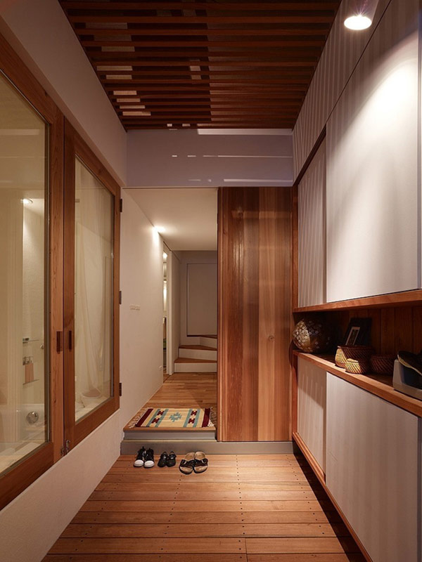 Long-corridor-for-acess-to-other-pllace-room-on-the-wooden-hpuse-with-laminate-flooring-and-wall-and-the-small-fur-rug-and-staircase-there-the-ceiling
