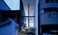 Viewed-exterior-by-a-narrow-house-on-the-night-with-glass-wall-and-very-good-lightness-so-amazing-design-house-and-very-tally-for-plan-small-house