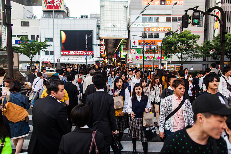 Crowds in the Minami shopping district of Osaka, Japan.