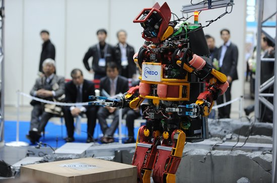 TOKYO, JAPAN - DECEMBER 03: A Humanoid Robot for Disaster of the New Energy and Industrial Technology Development Organiwation (NEDO) is seen during the international Robot exhibition 2015 at Tokyo Big Sight, Japan, on December 3, 2015. (Photo by David MAREUIL/Anadolu Agency/Getty Images)
